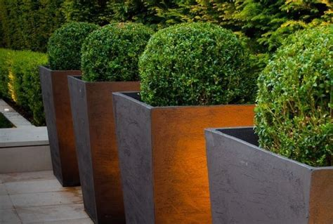 Chelsea Planters by The Chelsea Tapered Planter Available In An Bronze