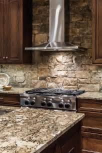 rock tile backsplash a stainless steel range is a sleek contemporary