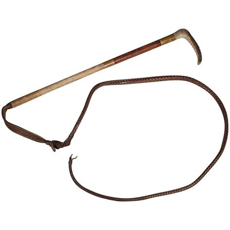 antique leather horn and steel crop and whip for