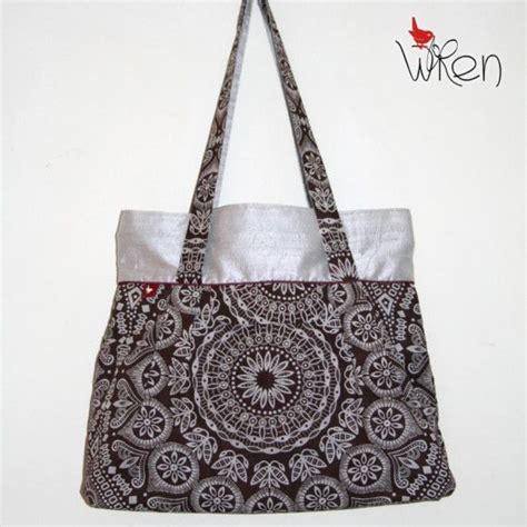 Alibi Afrro Sling Bag Silver silver silk and radiating brown shweshwe design big