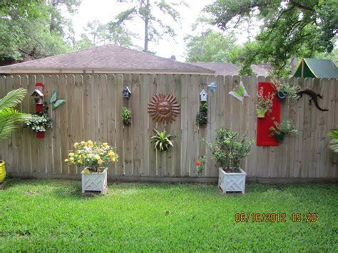 Backyard Wall Decorating Ideas Charming Combinations Of Ornament Which Is Placed On Wooden Perimeter Wall Using Outdoor Fence