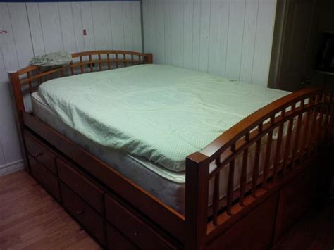 pull out twin bed trundle sleigh bed double pull out twin below 2