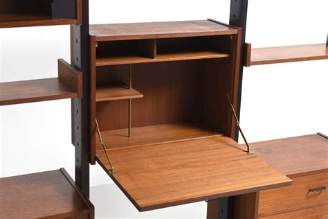 freestanding bookshelf in teak modestfurniture