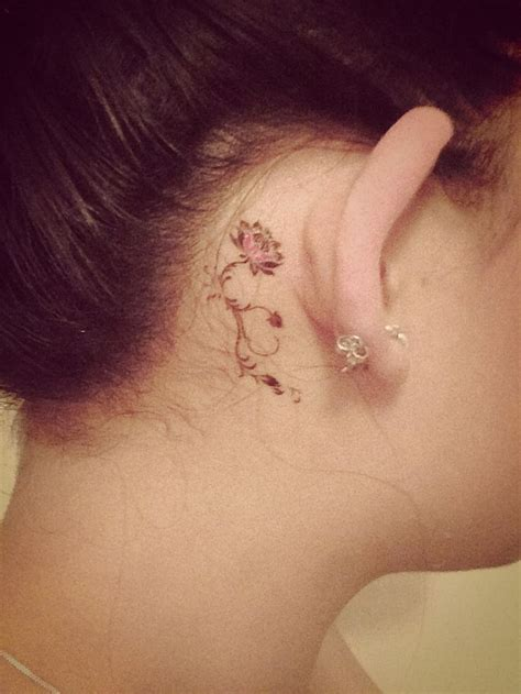 flower tattoo behind ear tattoo told tales pinterest