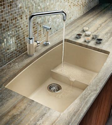 how to clean stained white corian sink advantages to buy a silgranit kitchen sink from blanco