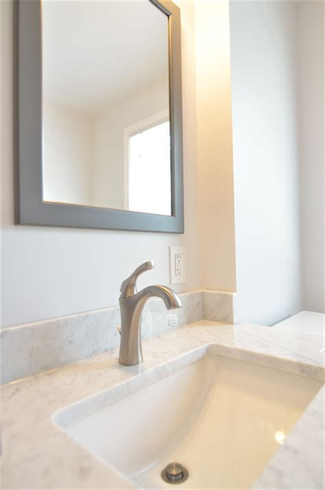 gray framed mirror detail transitional bathroom
