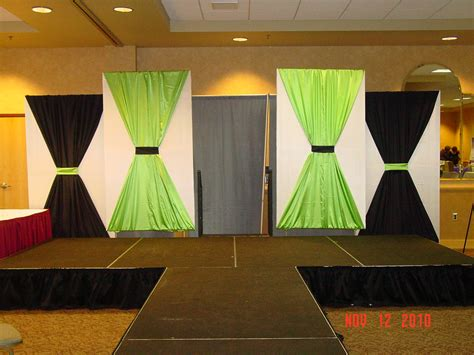 backdrop design for graduation stage decor for the women2women expo fabric covered