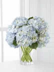 blue white and yellow flower arrangements blue