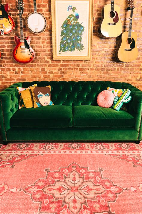 green velvet tufted sofa green velvet tufted sofa and pink rug