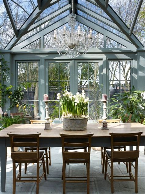 Conservatory Dining Table Traditional Glass Conservatory Sunroom With A Farmhouse Dining Table And Chandelier