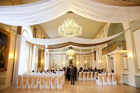 Drape for events   white voile & gold organza ceiling