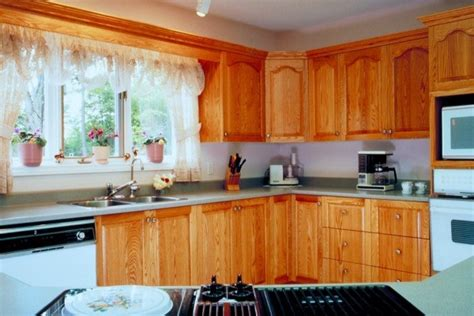 how to clean wooden kitchen cabinets cleaning nicotine stains on wood cabinets thriftyfun