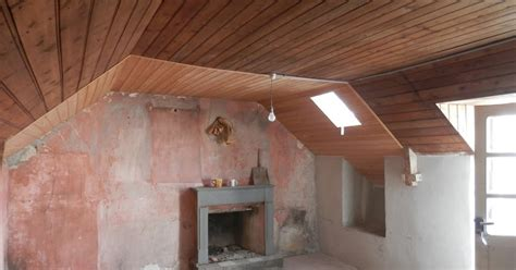 Creating A Vaulted Ceiling by Renovation Of A Derelict House In