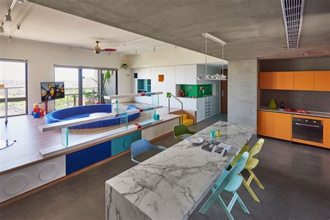 Designboom Interior Design | hao design organizes apartment around lego play pond