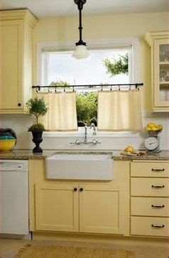 butter yellow kitchen cabinets butter yellow cabinets with white walls and sub tile donna