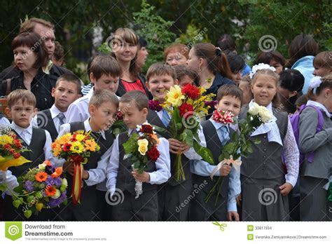 the one stand college student by day professional by books school students stand with flowers in on september 1