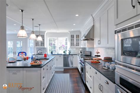 long island kitchen long island white kitchen featuring rutt regency cabinetry