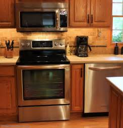 bronze colored appliances oak kitchen cabinets with bronze hardware quicua