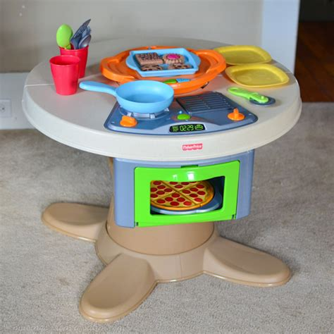 fisher price servin surprises kitchen table living