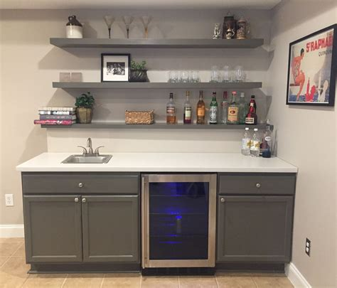 Basement Bar Cabinet Ideas Finally Finished Basement Bar Unfinished Cabinets Ikea Countertop And Ikea Floating Shelves