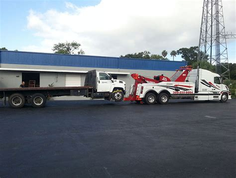 tow truck bed large tow truck towing flat bed truck buddy s towing daytona