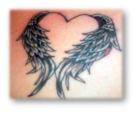 tattoo with angel wings and heart heart angel wings tattoo eemagazine com