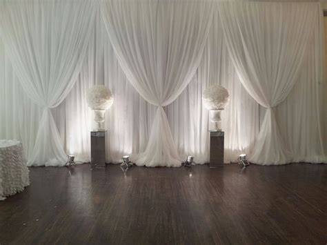 White Draping white backdrop draping with mirrored pillars wedding decor