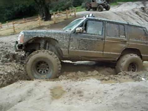 mud jeep cherokee jeep cherokee playing in mud below truck hill youtube