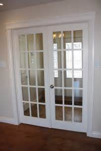 Interior sliding french door in white with silver metal knob hardware