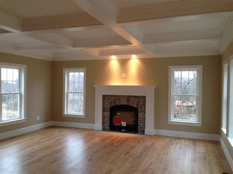 wood trim around fireplace coffered ceiling and custom wood mantle fireplace