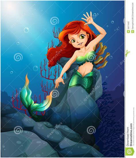 imagenes de sirenas muy bonitas una sirena bonita atrapada con las rocas grandes debajo