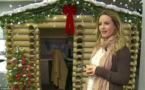 epic holiday office decorating contest saleswoman transforms desk space into a cozy log house daily mail