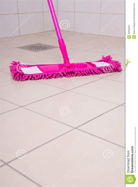 bathtub mop washing of tile floors by pink mop stock image image