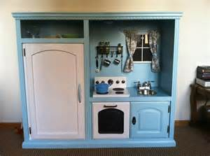 tv cabinet made into play kitchen diy play kitchen out of a old entertainment center imgur