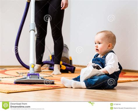 Baby Clean Floor by Cleaning Home And Child Stock Images Image