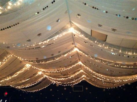 Gossamer Ceiling Decoration by Lights Draped From Ceiling With White Gossamer And