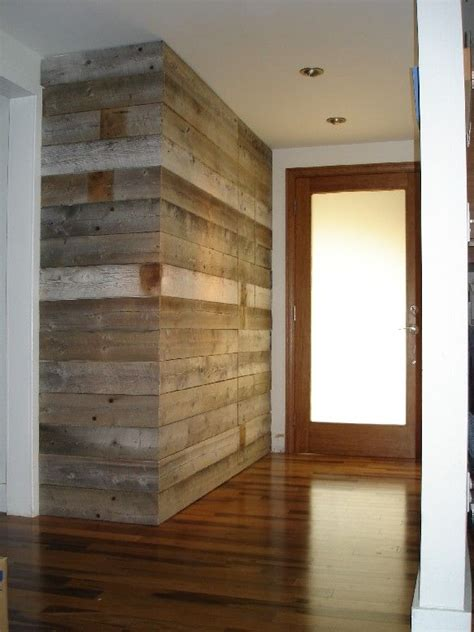 entryway wall built  reclaimed barn wood concealed