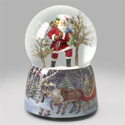 santa brings joy snow globe global shakeup snowdomes com