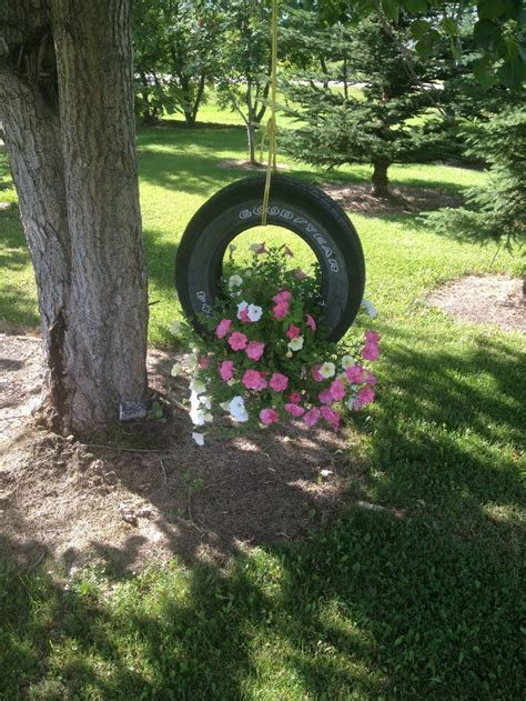 old tire swing great use for an old tire swing landscaping pinterest
