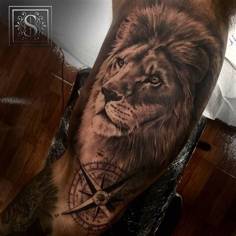 black  grey style lion tattoo     arm