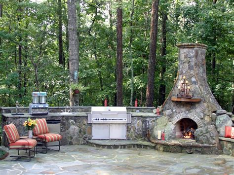 unique stone table with fireplace completing outdoor 13 outdoor kitchen countertop options hgtv