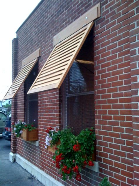 awnings and shutters solid wood window awnings by crestview doors home crafts