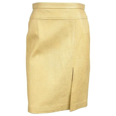 1990s new stock gold escada leather skirt for sale at