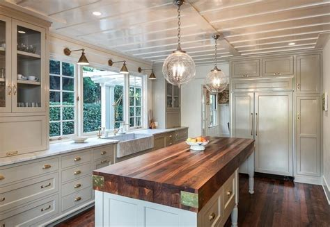 cottage kitchen with farmhouse sink wood counters in