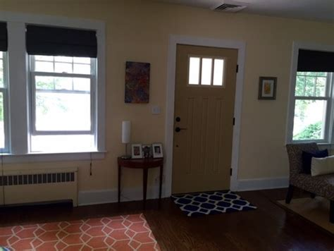 front door in living room living room with door in middle and two additional openings help