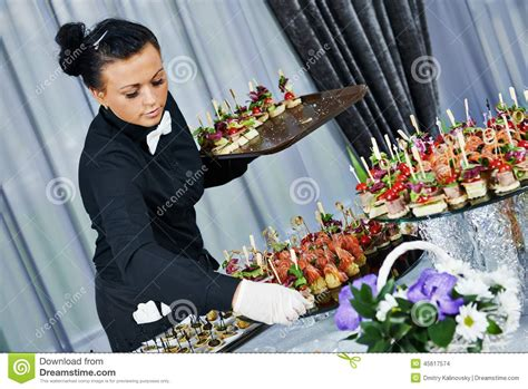 waiter serving catering table stock photo image 45617574