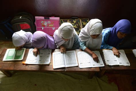 child studying koran schools around the world photos the big picture