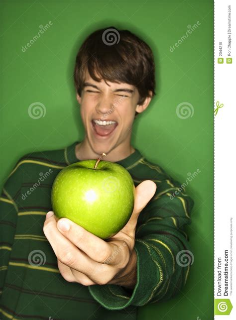 cute teen boy stock photos pictures royalty free cute teen boy holding apple stock image image of health