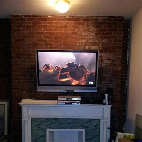mount tv brick fireplace brick wall mounted tv on tilt mount above fireplace yelp