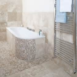 Travertine tiles and small mosaic tiles add interest to this bathroom